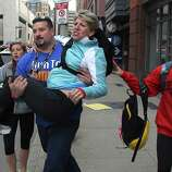 BOSTON - APRIL 15: A woman is carried from the scene on Exeter Street after two explosions went off on Boylston Street near the finish line of the 117th Boston Marathon on April 15, 2013.