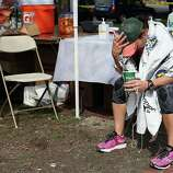 BOSTON, MA - APRIL 15:  A runner sits near Kenmore Square after two bombs exploded during the 117th Boston Marathon on April 15, 2013 in Boston, Massachusetts. Two people are confirmed dead and at least 23 injured after two explosions went off near the finish line to the marathon.