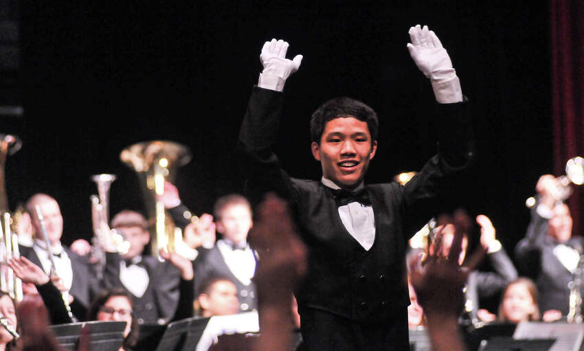 Churchill High School drum major Alex Bi leads the band as it was announced that they would march in the 2014 Macy's Thanksgiving Day Parade in New York City.