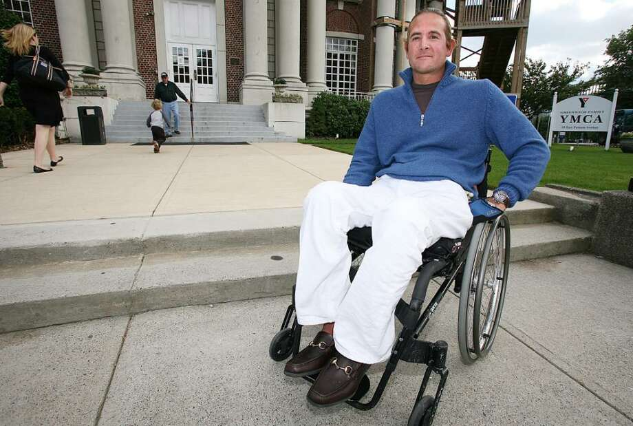 Luis Gonzalez-Bunster, seen here in front of the Greenwich Family YMCA in October 2008, has been battling the YMCA to make the facility handicapped accessible. Photo: David Ames / Greenwich Time