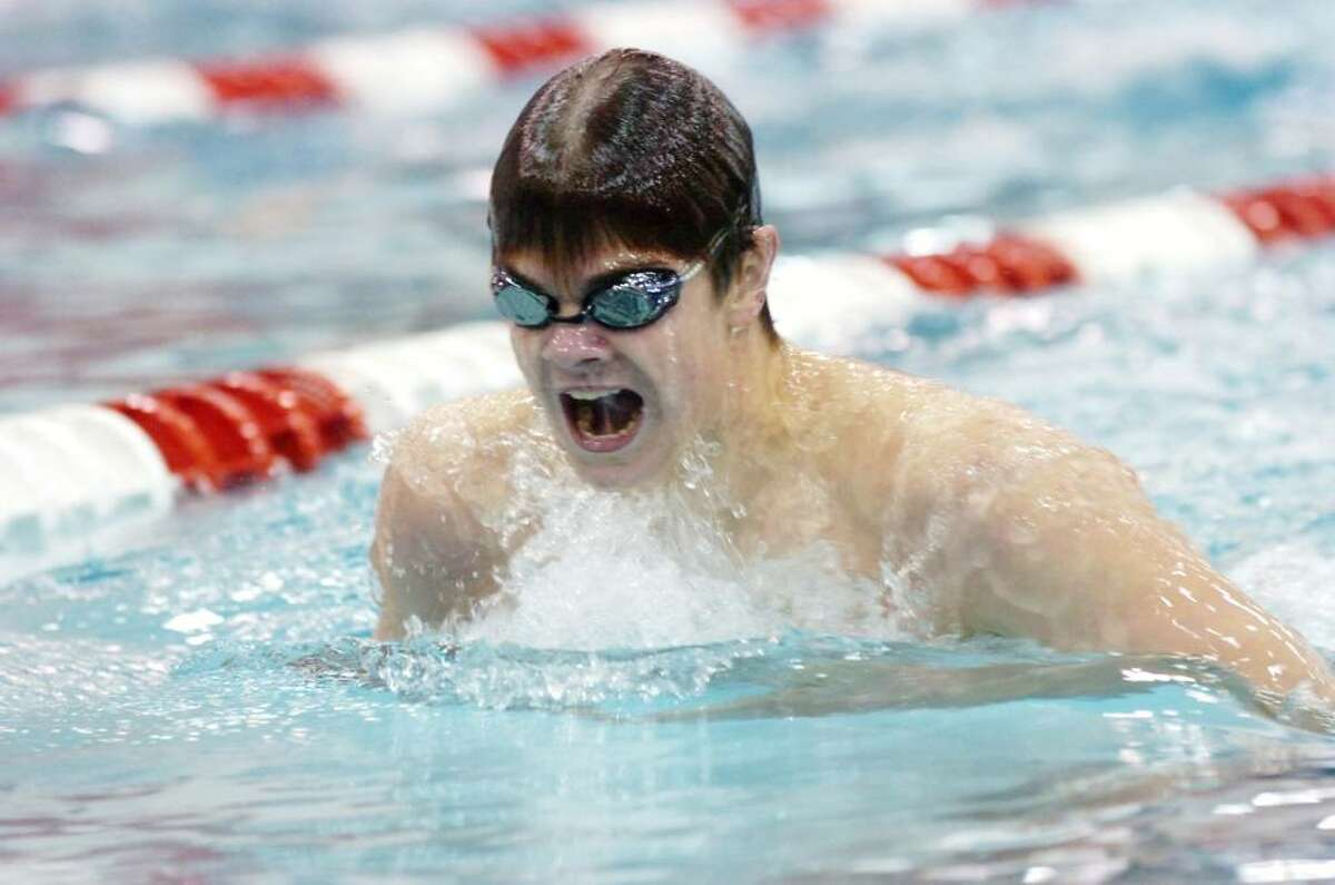 Greenwich's Andrew Dillinger in the butterfly leg of the 200 IM as Greenwich hosts Darien in a swim meet Wednesday afternoon, January 6, 2009. Greenwich won the meet 128-58.