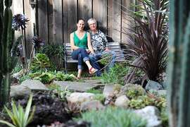 Gabrielle Scolnick-Bussey and her husband Brad Bussey pose for a portrait in their Bay-friendly garden at their home in Oakland, CA Saturday April 13th, 2013.