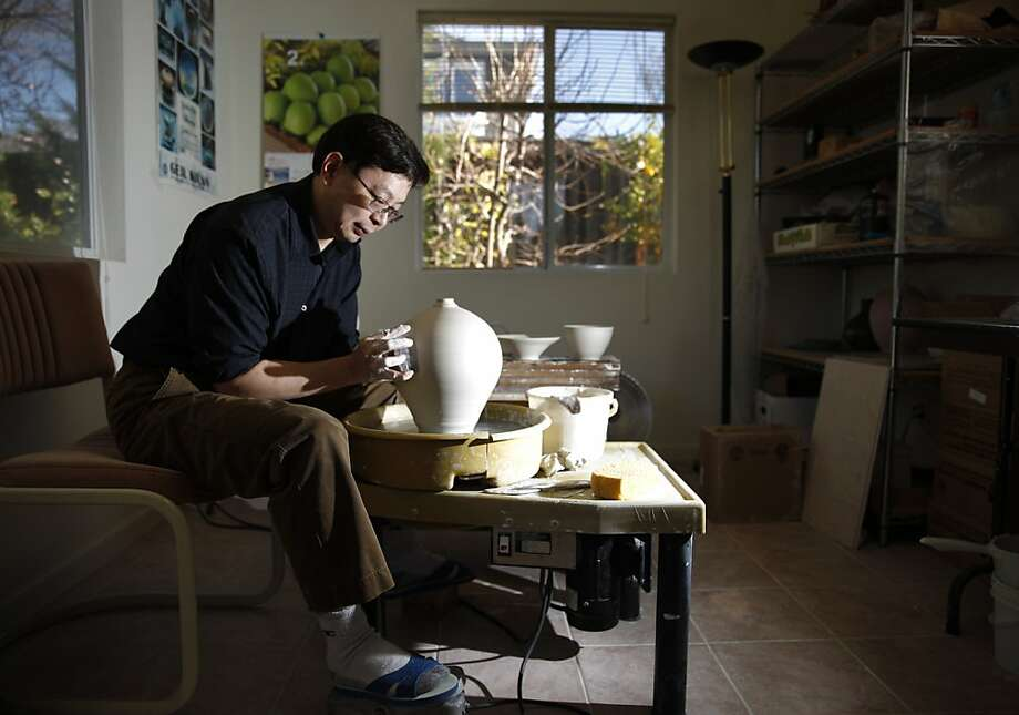 Hsin-Chuen Lin, shaping a vase at his home studio in Fremont, was inspired by singer Susan Boyle to post on YouTube. Photo: Lea Suzuki, The Chronicle