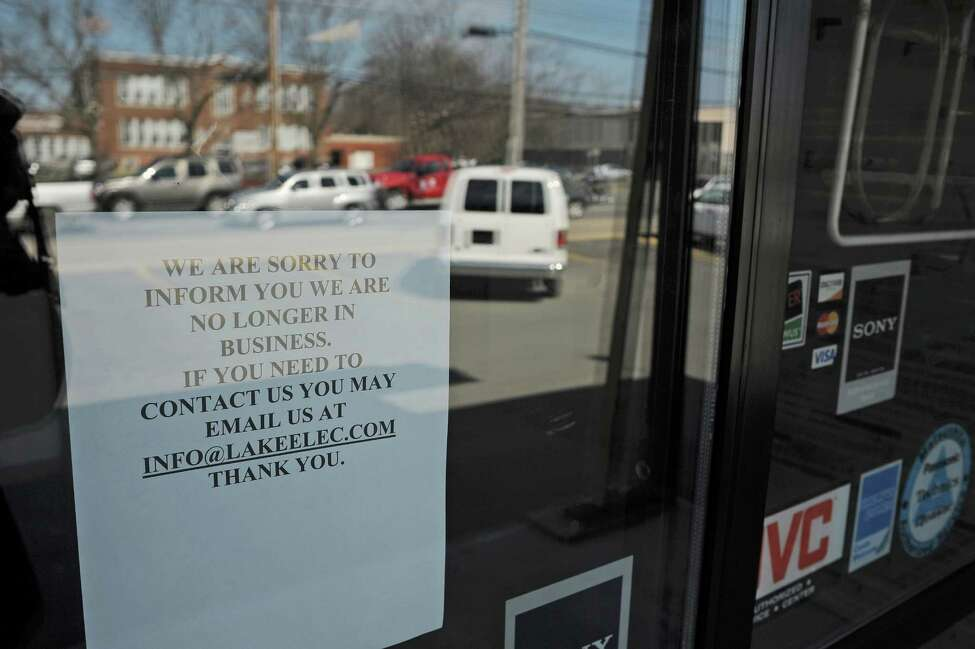 A sign on the front door at Lake Electronics store on Central Ave. on Monday, April 15, 2013 in Colonie, NY. The store has recently closed. (Paul Buckowski / Times Union)