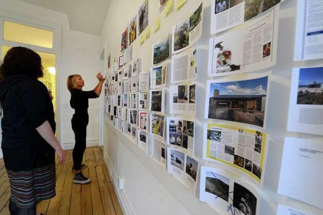 Founder and editor of the new Modern Farmer magazine, Ann Marie Gardner right looks over page comps to determine the positioning of ads,  April 12, 2013 at their offices in Hudson, N.Y.    Working with Gardner is deputy editor Reyhan Harmandi.  (Skip Dickstein/Times Union) Photo: SKIP DICKSTEIN / 10021955A