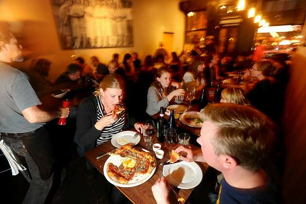 Ingrid Karlsson and Alexander Andreeff, right, eat pizza at Ragazza. Photo: Noah Berger, Special To The Chronicle