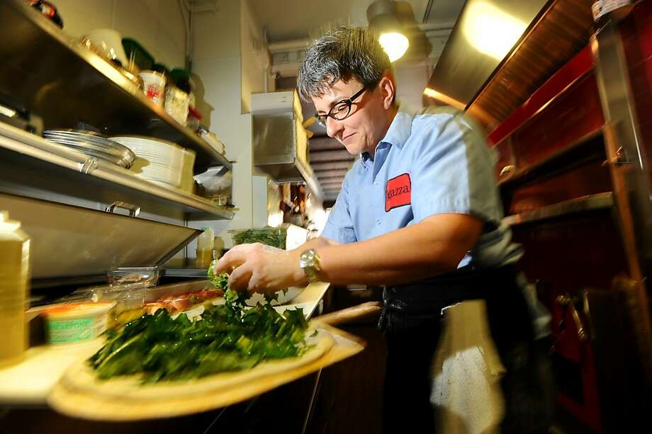 Chef-owner Sharon Ardiana prepares a spigarello pizza at Ragazza in San Francisco. Photo: Noah Berger, Special To The Chronicle