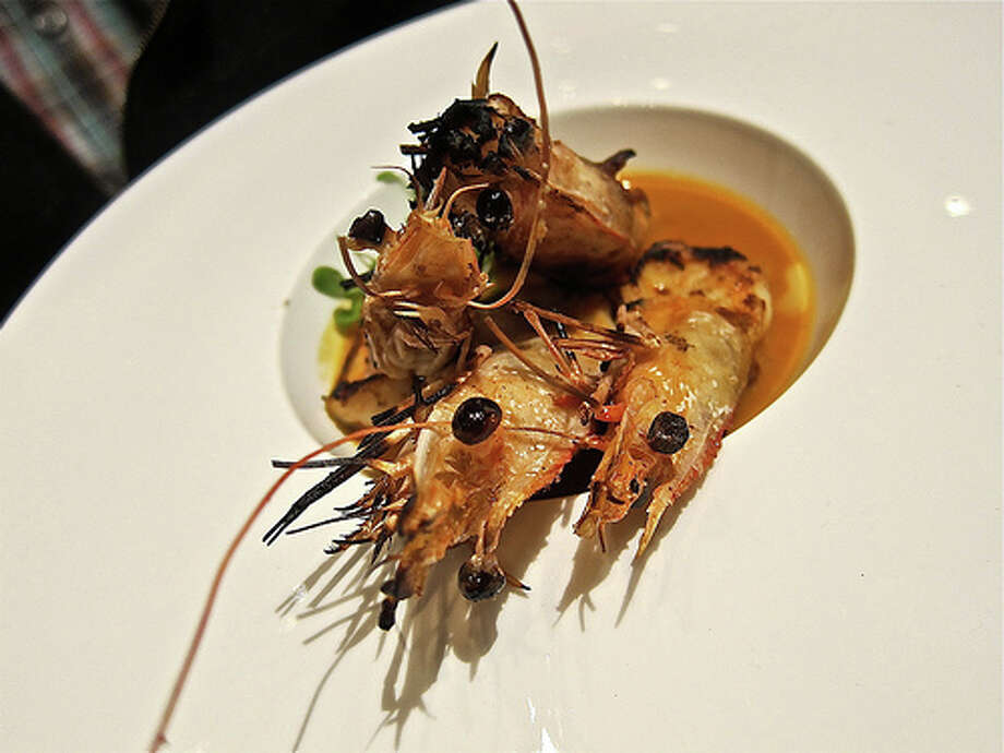 Gulf Shrimp Americain, bulging black satin eyes and all, in a bisque sauce at Kris Bistro .