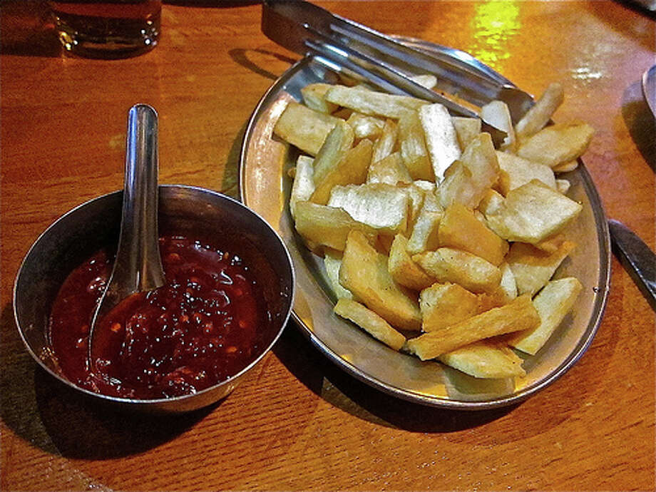 Mogo fries made of cassava root, with hot-as-blazes peri peri sauce at London Sizzler. Photo by Alison Cook