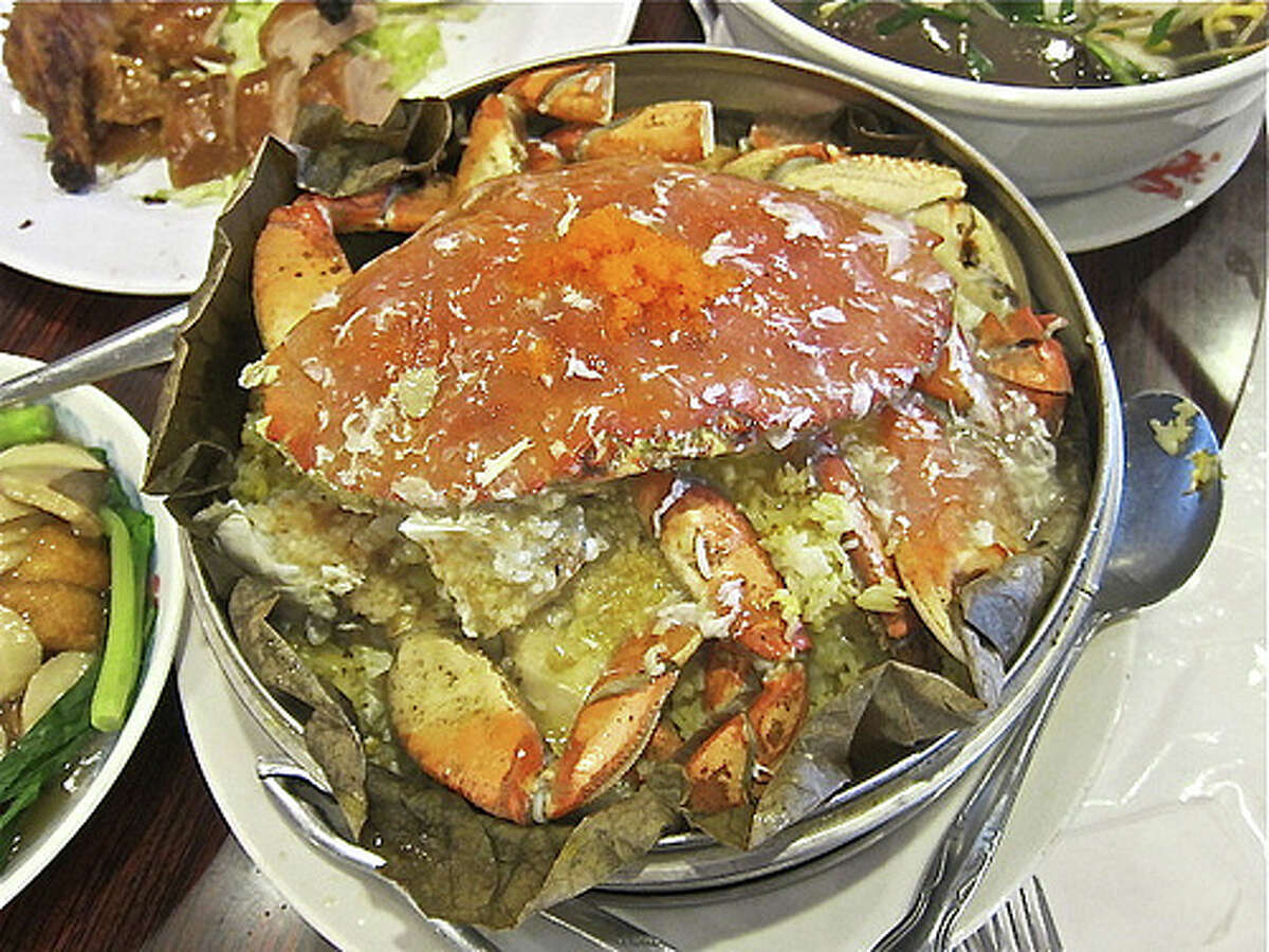 Whole Dungeness crab with lobster sauce steamed in a lotus leaf at Confucius Seafood Restaurant. Photo by Alison Cook