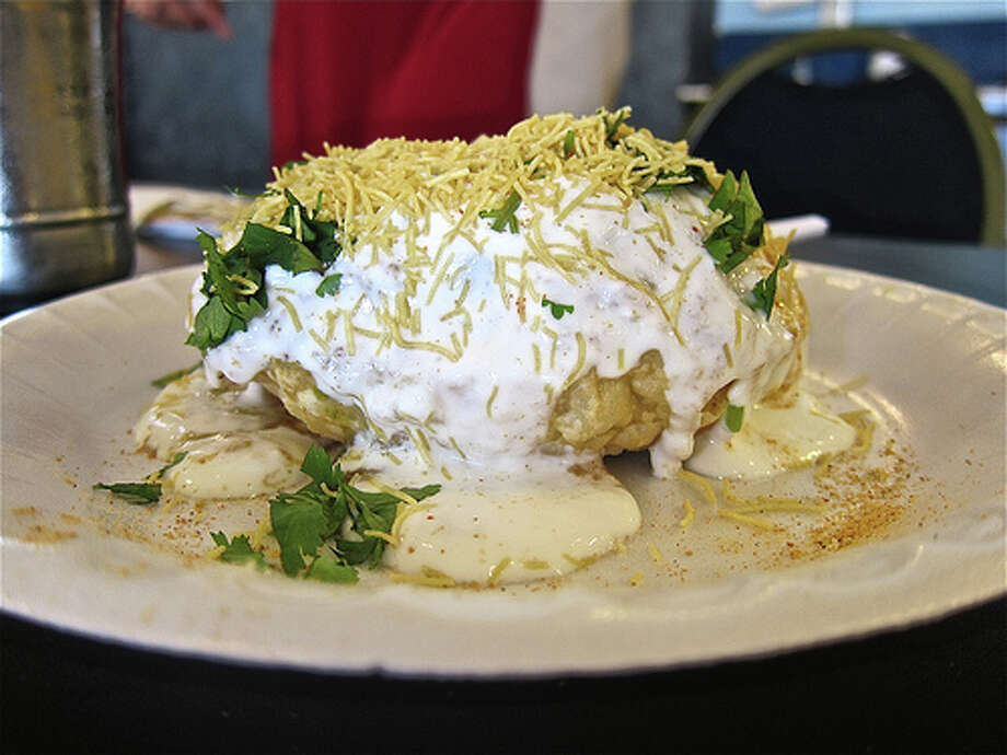 Khasta Khachori, a giant lentil puff filled with spicy chickpeas and chutneys, then doused with yogurt, cilantro and fried noodles; at Vishala Gujarati buffet. Photo by Alison Cook