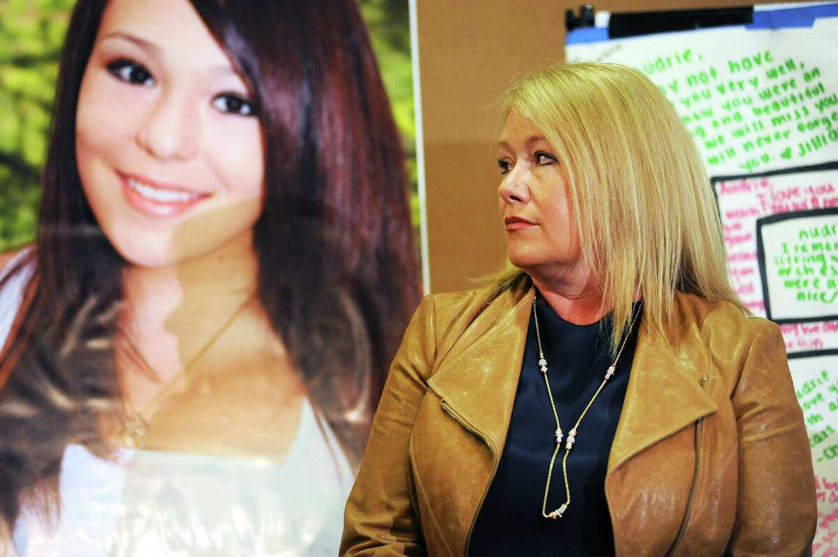 Audrie's mother Sheila Pott stands next to a photo of her daughter during a press conference at the Radisson Hotel in San Jose, CA Monday April 15th, 2013.