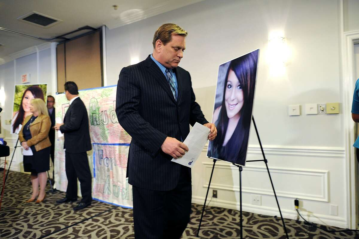 Audrie's father Larry Pott walks past a photo of his late daughter at the conclusion of a press conference at the Radisson Hotel in San Jose, CA Monday April 15th, 2013.