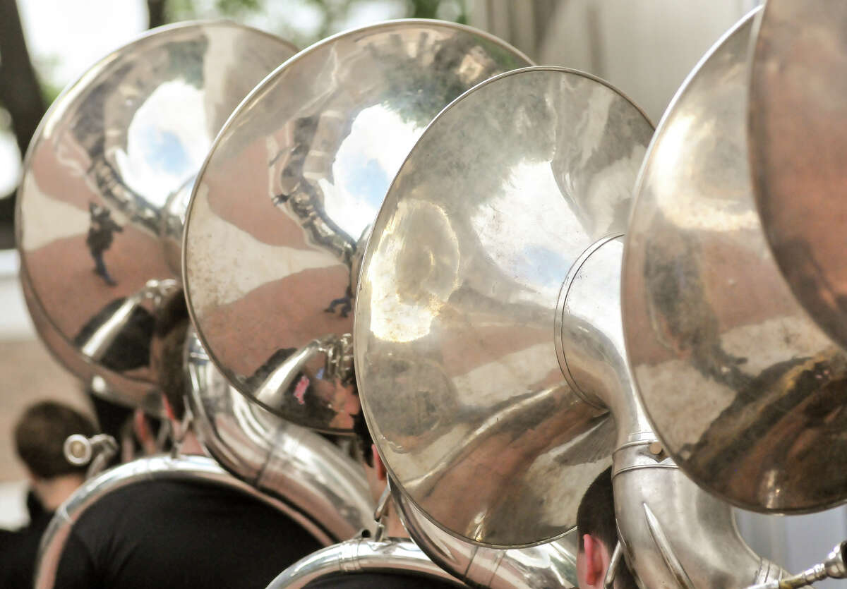 The tuba section of the Churchill High School Band enters the school auditorium Monday for the announcement that they will march in the 2014 Macy's Thanksgiving Day Parade.