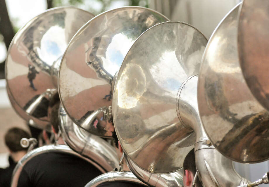 The tuba section of the Churchill High School Band enters the school auditorium Monday for the announcement that they will march in the 2014 Macy's Thanksgiving Day Parade. Photo: Robin Jerstad