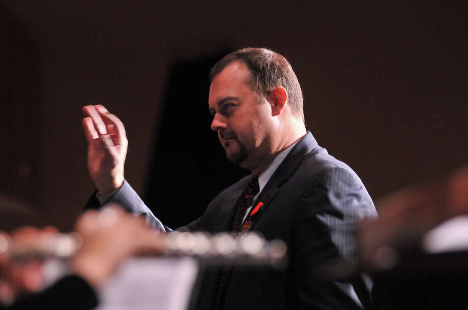 Churchill High School band director Brian Pollard leads the band as it was announced that they would march in the 2014 Macy's Thanksgiving Day Parade in New York City. Photo: Robin Jerstad