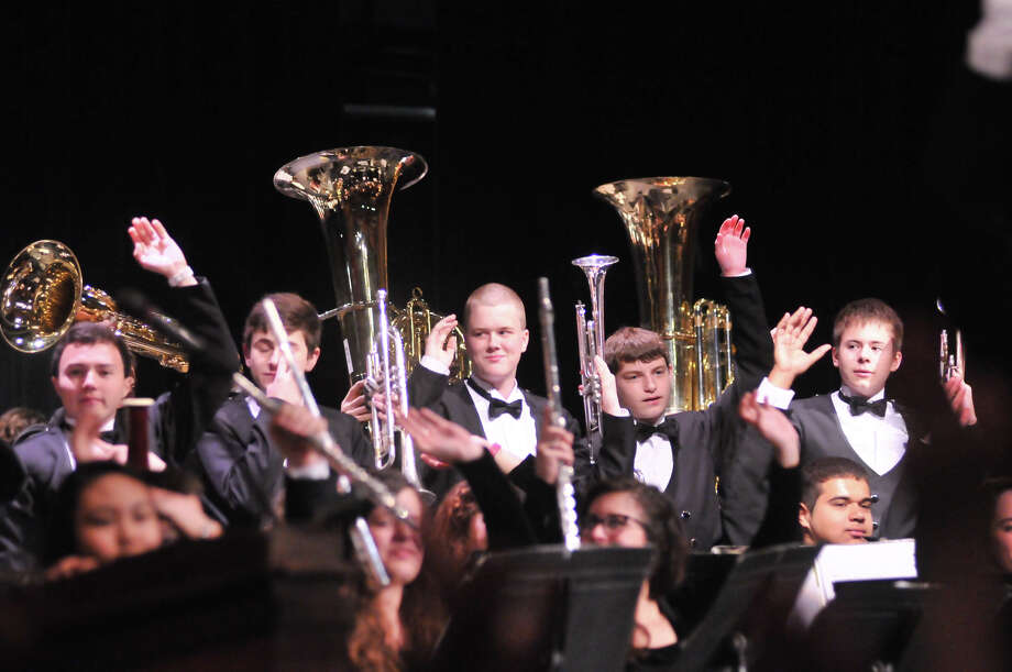The Churchill High School Band reacts to the announcement Monday that they will march in the 2014 Macy's Thanksgiving Day Parade. Photo: Robin Jerstad / For The S.A. Express-News