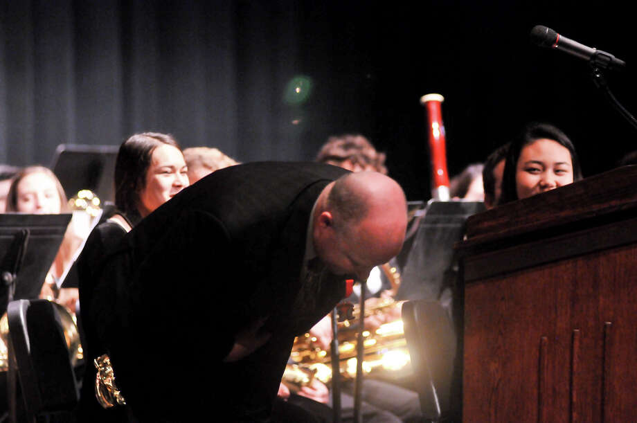 "County Commissioner Kevin Wolff, a Clark High School graduate, ""bows to Churchill"" band students following the announcement Monday that they will march in the 2014 Macy's Parade. Photo: Robin Jerstad"