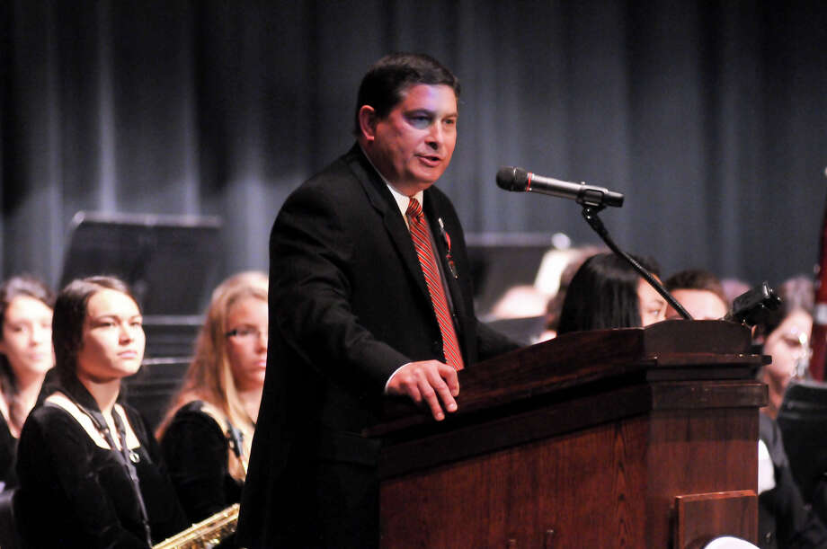 North East Independent School District Superintendent Dr. Brian Gottardy congratulates the Churchill High School Band following the announcement Monday that they will march in the 2014 Macy's Thanksgiving Day Parade. Photo: Robin Jerstad