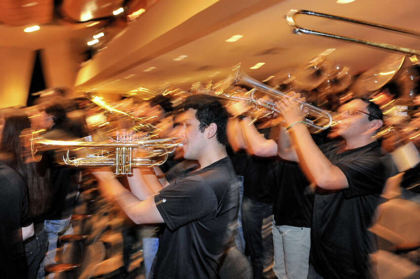 Churchill Band members Jeremiah Laija (left) and Clarence Canizalez play as it was announced Monday that the band would march in the 2014 Macy's Thanksgiving Day Parade.