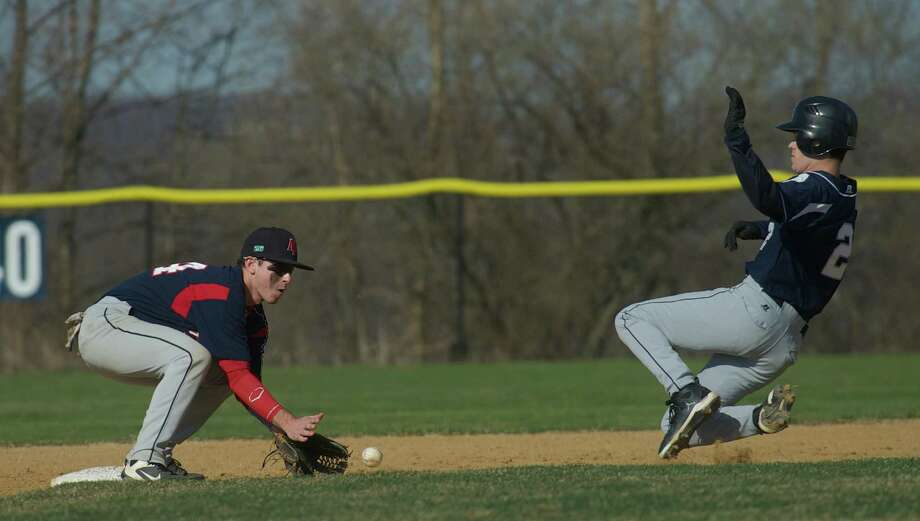 New Fairfield's Jake Patton waits for the ball as Immaculate High School's Matt Ryan slides safely into second base during a boys baseball game at New Fairfield High School, Conn, Monday April 15th, 2013. Photo: H John Voorhees III