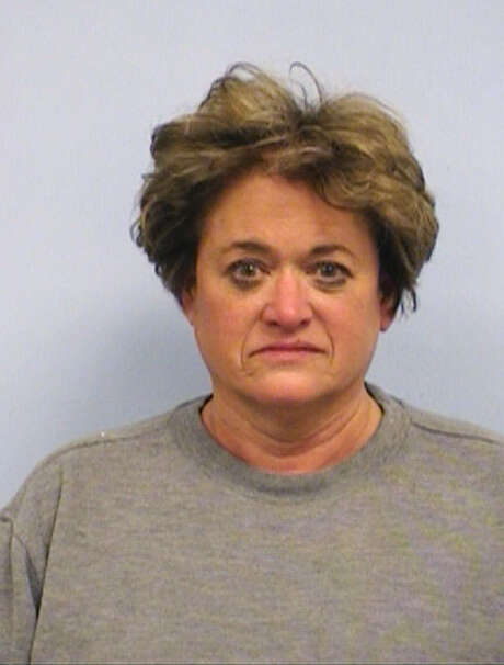 Rosemary Lehmberg had an open bottle of vodka on her front seat when she was stopped. Photo: HOPD / Travis County Sheriff's Office