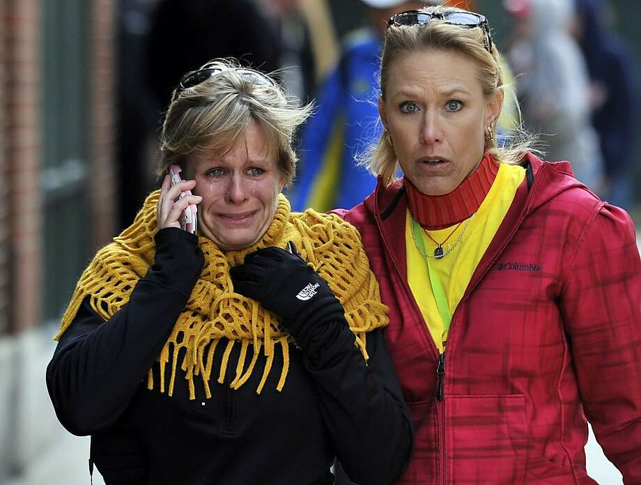 Women react as they walk from the area where there was an explosion after the Boston Marathon. Photo: Josh Reynolds, Associated Press