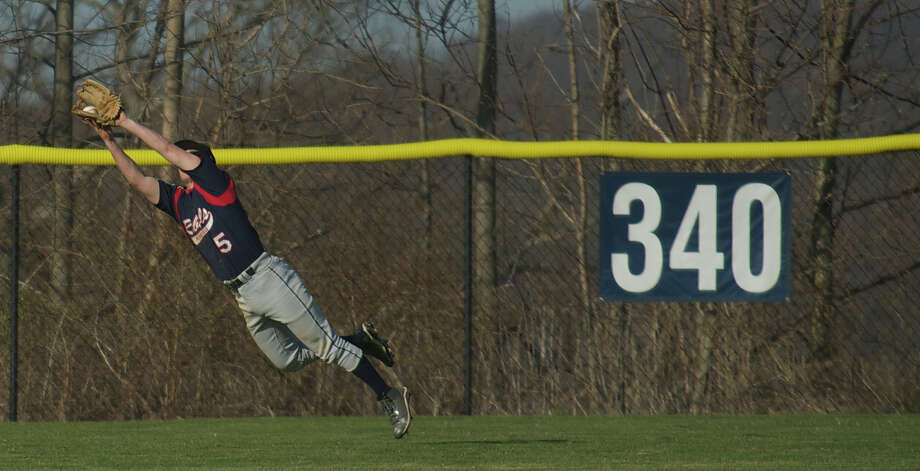 New Fairfield High School's Antonio Dimaggio makes a diving catch in the outfield during a  boys baseball game against Immaculate High School played at New Fairfield High School, Conn, Monday April 15th, 2013. Photo: H John Voorhees III