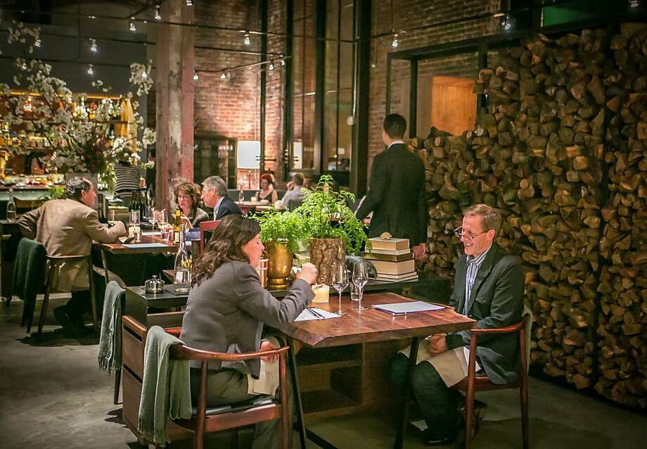 At Saison, the interior is cutting-edge industrial, with a kitchen that flows into the dining room. Photo: John Storey, Special To The Chronicle