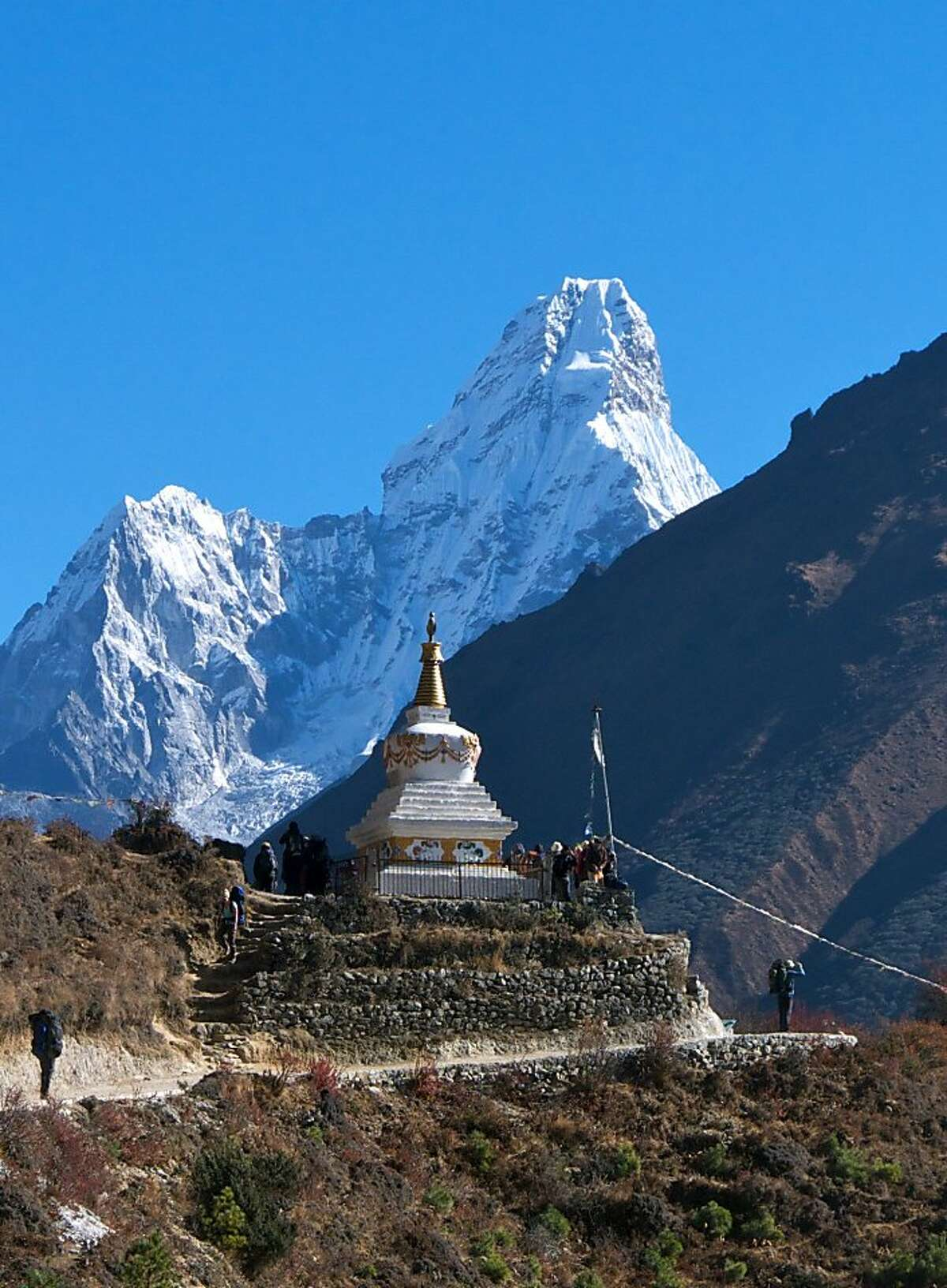 A chorten echoes the stunning shape of Ama Dablam, considered by many to be the most beautiful peak in the Himalayas.