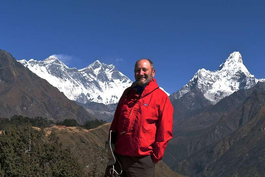 Writer John Flinn poses in front of Everest. Photo: John Flinn, Special To The Chronicle