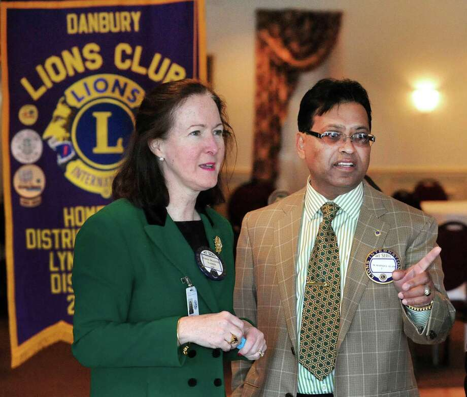 Mohammad Alam talks with Danbury Probate Judge Dianne Yamin, who sponsored him into the club 17 years ago, during the weekly luncheon meeting of the Danbury Lions Club, at Anthony's Lake Club in Danbury, Conn. Thursday, March 14, 2013. Photo: Michael Duffy / The News-Times