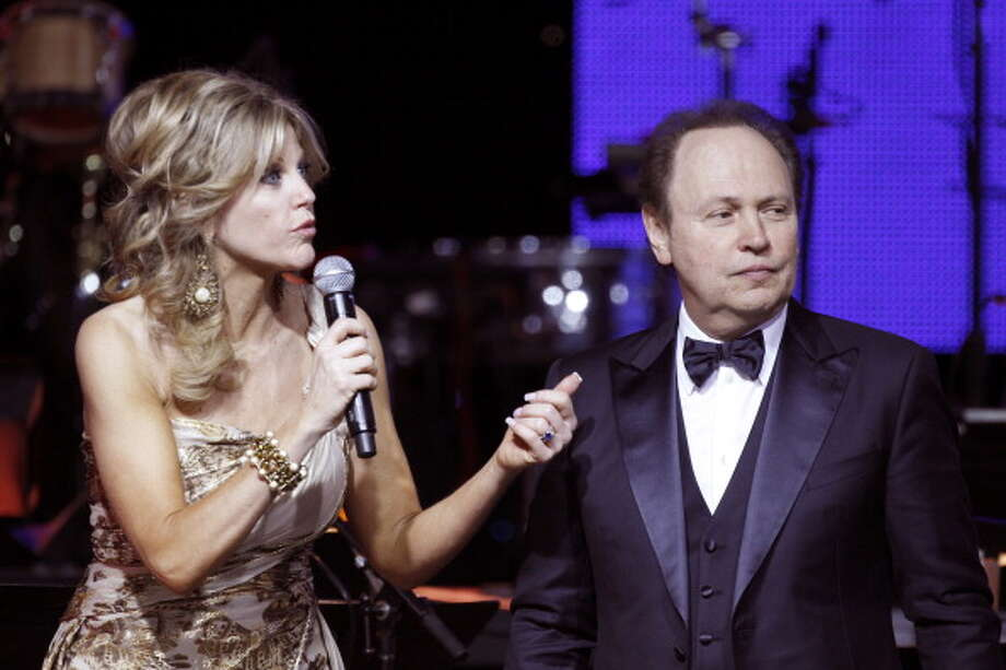 Billy Crystal with Tara Hitchcock at the Muhammad Ali\'s Celebrity Fight Night XIX in 2013. Photo: Mike Moore / 2013 Getty Images