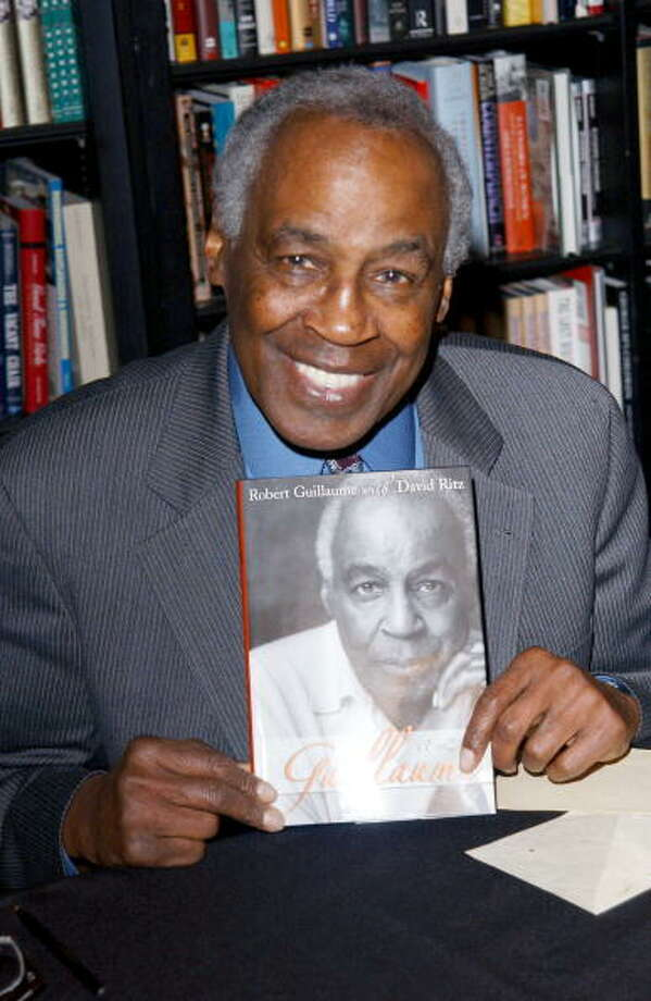 Robert Guillaume signs his book, \'\'Guillaume: A Life\'\' in 2002. Photo: Jon Kopaloff, Getty Images / 2002 Getty Images