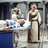 Episode 50 - Season Three - 9/27/79 Saul (Jack Gilford), a 4,000-year-old man captured by the aliens, offered to help Burt (Richard Mulligan, on table) escape.  (AMERICAN BROADCASTING COMPANIES, INC.)