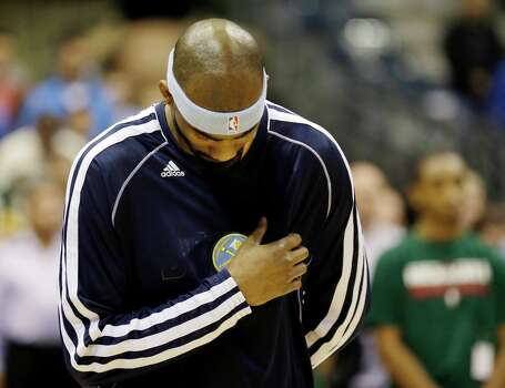 Denver Nuggets' Corey Brewer takes part in a moment of silence for the victims of the explosions at the Boston Marathon before their NBA basketball game against the Milwaukee Bucks, Monday, April 15, 2013, in Milwaukee. Photo: AP