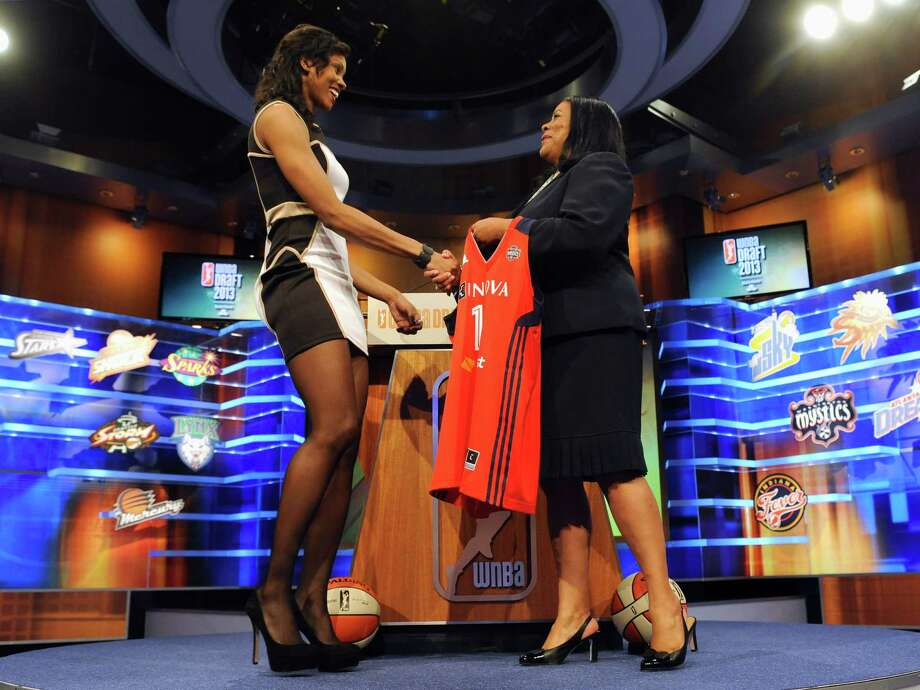 Ohio State's Tayler Hill is presented a Washington Mystics jersey with WNBA president Laurel J. Richie after Washington selected Bone as the No. 4 pick in the WNBA basketball draft in Bristol in Bristol, Conn., Monday, April 15, 2013. (AP Photo/Jessica Hill) Photo: Jessica Hill, Associated Press / FR125654 AP