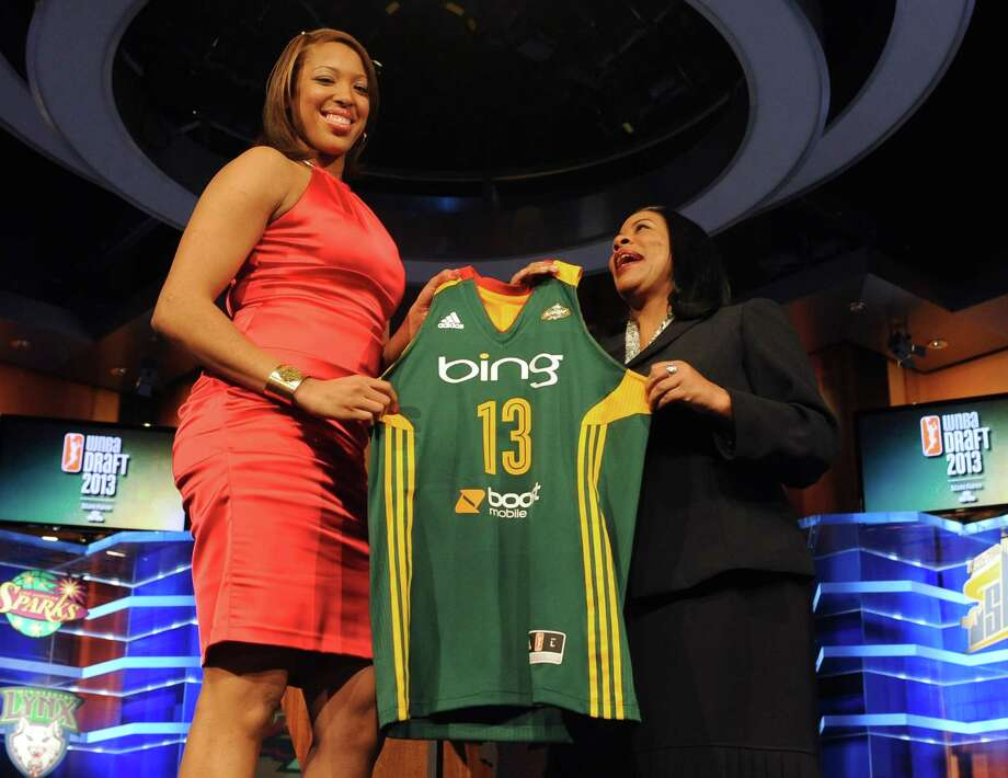 Maryland's Tianna Hawkins holds up a Seattle Storm jersey with WNBA president Laurel J. Richie after Seattle selected Hawkins as the No. 6 pick in the WNBA basketball draft in Bristol in Bristol, Conn., Monday, April 15, 2013. (AP Photo/Jessica Hill) Photo: Jessica Hill, Associated Press / FR125654 AP
