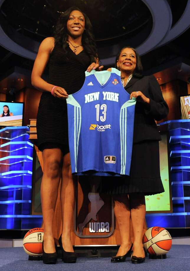 Texas A&M's Kelsey Bone holds up a New York Liberty jersey with WNBA president Laurel J. Richie after New York selected Hawkins as the No. 5 pick in the WNBA basketball draft in Bristol in Bristol, Conn., Monday, April 15, 2013. (AP Photo/Jessica Hill) Photo: Jessica Hill, Associated Press / FR125654 AP
