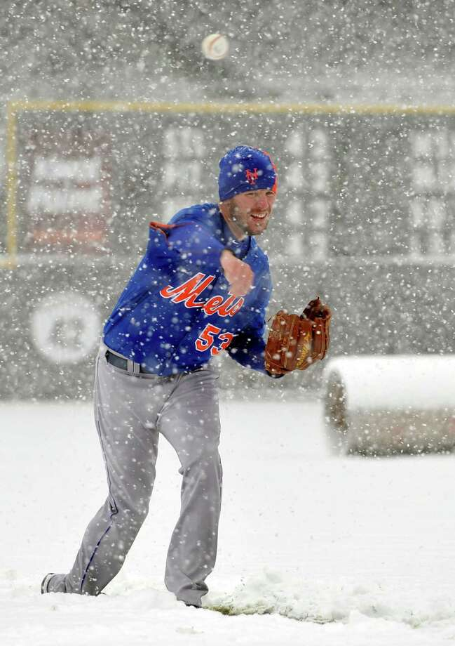 New York Mets pitcher Jeremy Hefner throws in the snow before a scheduled baseball game against the Colorado Rockies, Monday, April 15, 2013, in Denver. The game has been canceled. (AP Photo/Jack Dempsey) Photo: JACK DEMPSEY
