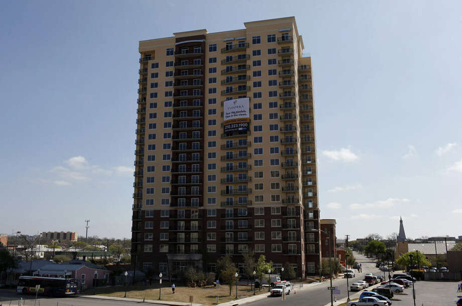 Thirty-six of 39 units, not counting the penthouse floor, at the Vidorra condominium tower sold at a weekend auction. The tower, which has 20 stories and 146 units, opened in 2009. Photo: San Antonio Express-News File Photo