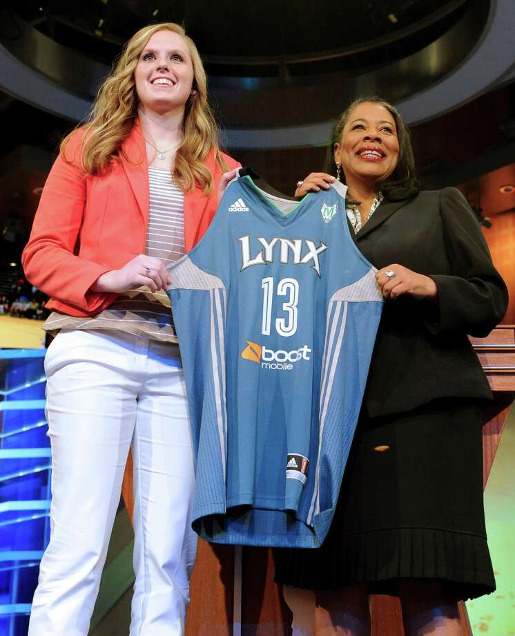 Nebraska's Lindsey Moore holds up a Minnesota Lynx jersey with WNBA president Laurel J. Richie after Minnesota selected Moore as the No. 12 pick in the WNBA basketball draft in Bristol, Conn., Monday, April 15, 2013. (AP Photo/Jessica Hill) Photo: Jessica Hill, Associated Press / FR125654 AP