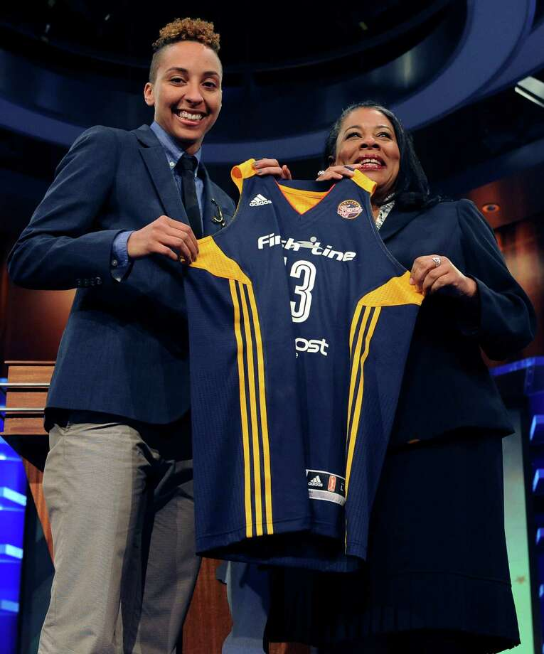 California's Layshia Clarendon holds up an Indiana Fever jersey with WNBA president Laurel J. Richie after Indiana selected Clarendon as the No. 9 pick in the WNBA basketball draft in Bristol, Conn., Monday, April 15, 2013. (AP Photo/Jessica Hill) Photo: Jessica Hill, Associated Press / FR125654 AP