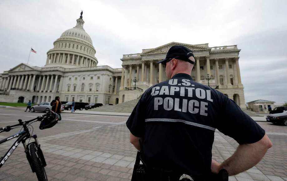 A law enforcement officer stands post at the U.S. Capitol, Monday, April 15, 2013 in Washington. Authorities say the blasts during the Boston Marathon killed two people and injured at least 73,(AP Photo/Alex Brandon) Photo: Alex Brandon
