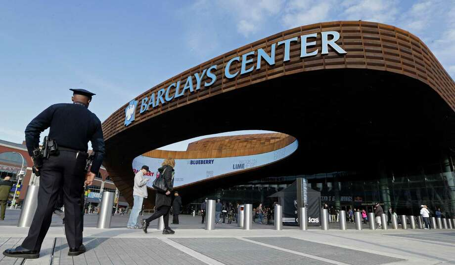 A police officer patrols the area in front of the Barclays Center in New York, Monday, April 15, 2013, before a Brooklyn Nets NBA basketball game in the wake of the explosions at the Boston Marathon.  (AP Photo/Kathy Willens) Photo: Kathy Willens
