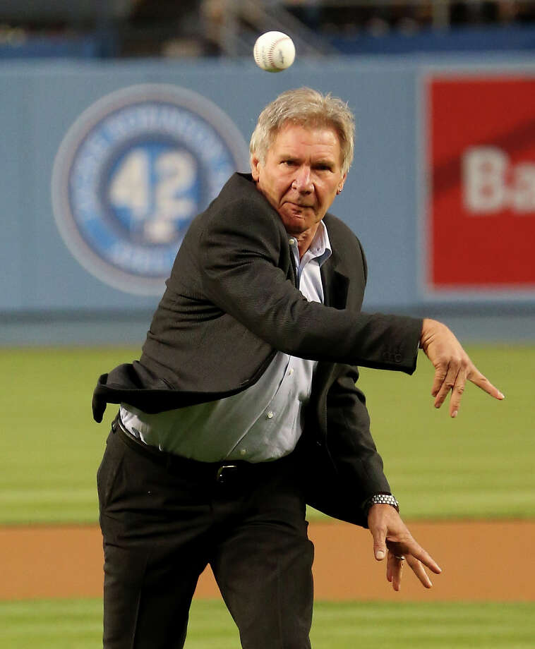 LOS ANGELES, CA - APRIL 15: Actor Harrison Ford, who plays Branch Rickey in the Jackie Robinson biography movie 42, throws out the first pitch before the game between the San Diego Padres and the Los Angeles Dodgers at Dodger Stadium on April 15, 2013 in Los Angeles, California.  All uniformed team members are wearing jersey number 42 in honor of Jackie Robinson Day. Photo: Stephen Dunn, Getty Images / 2013 Getty Images