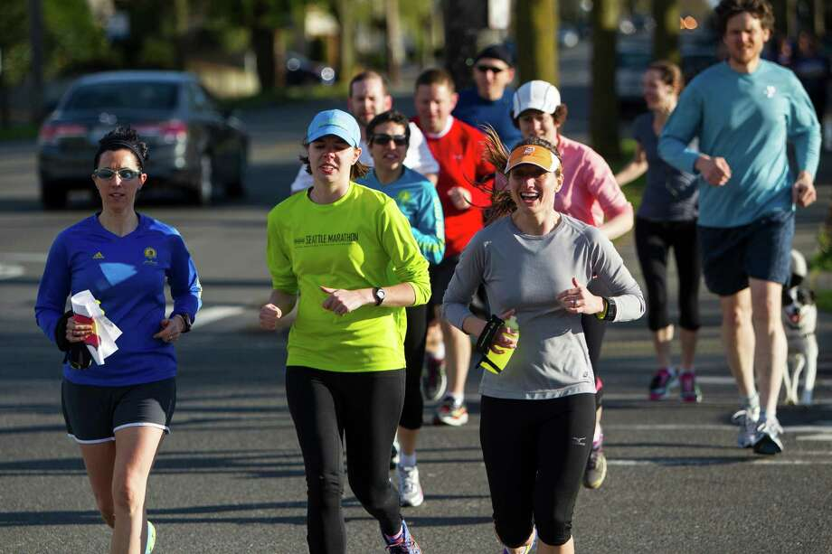 Attendees jog as a group during an organized run to relieve the stresses of the Boston bombings Monday, April 15, 2013, in West Seattle. The group ran a loop from the West Seattle Runners store to Southwest Massachusetts Street and California Avenue Southwest intersection and back again. Photo: JORDAN STEAD / SEATTLEPI.COM
