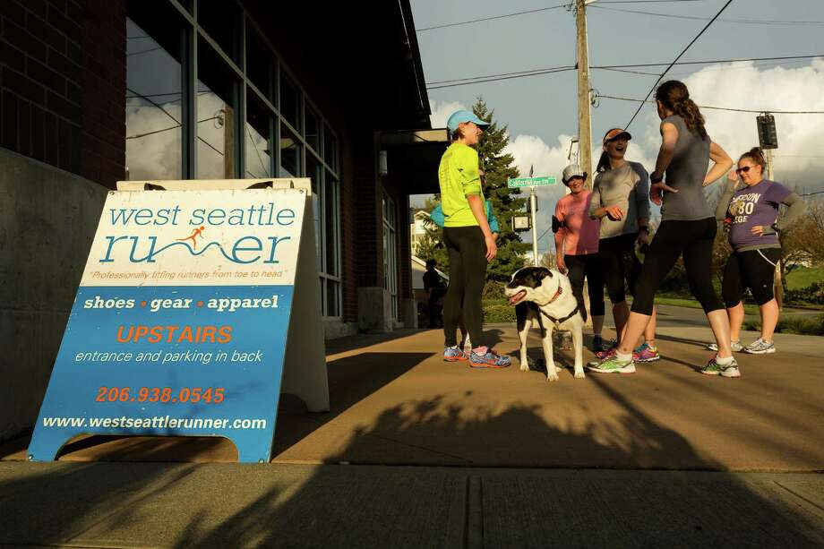A group of runners relax following an organized run to relieve the stresses of the Boston bombings Monday, April 15, 2013, in West Seattle. The group ran a loop from the West Seattle Runners store to Southwest Massachusetts Street and California Avenue Southwest intersection and back again. Photo: JORDAN STEAD / SEATTLEPI.COM