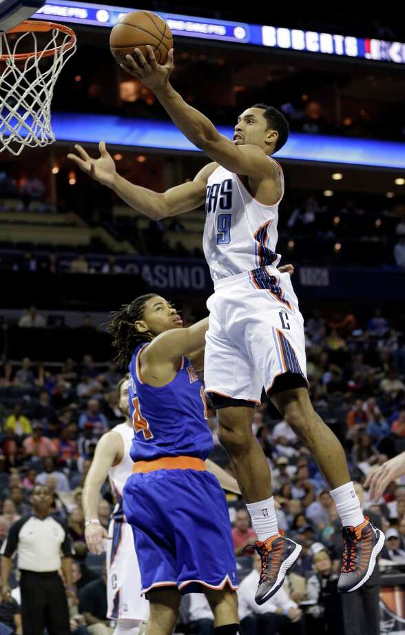 Charlotte Bobcats' Gerald Henderson (9) drives past New York Knicks' Chris Copeland (14) during the first half of an NBA basketball game in Charlotte, N.C., Monday, April 15, 2013. (AP Photo/Chuck Burton) Photo: Chuck Burton