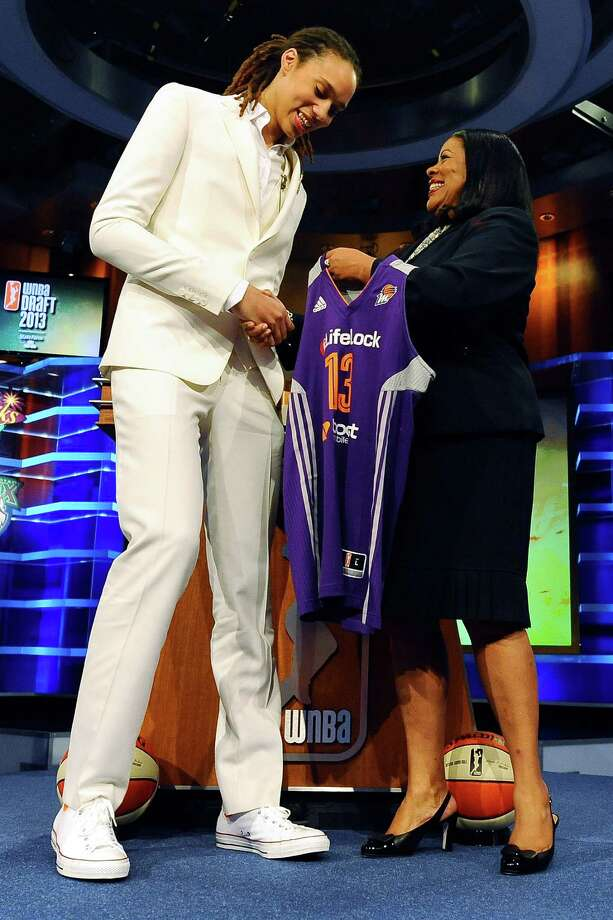 Phoenix-bound Brittney Griner, left, is greeted by WNBA president Laurel J. Richie. Photo: Jessica Hill, FRE / FR125654 AP